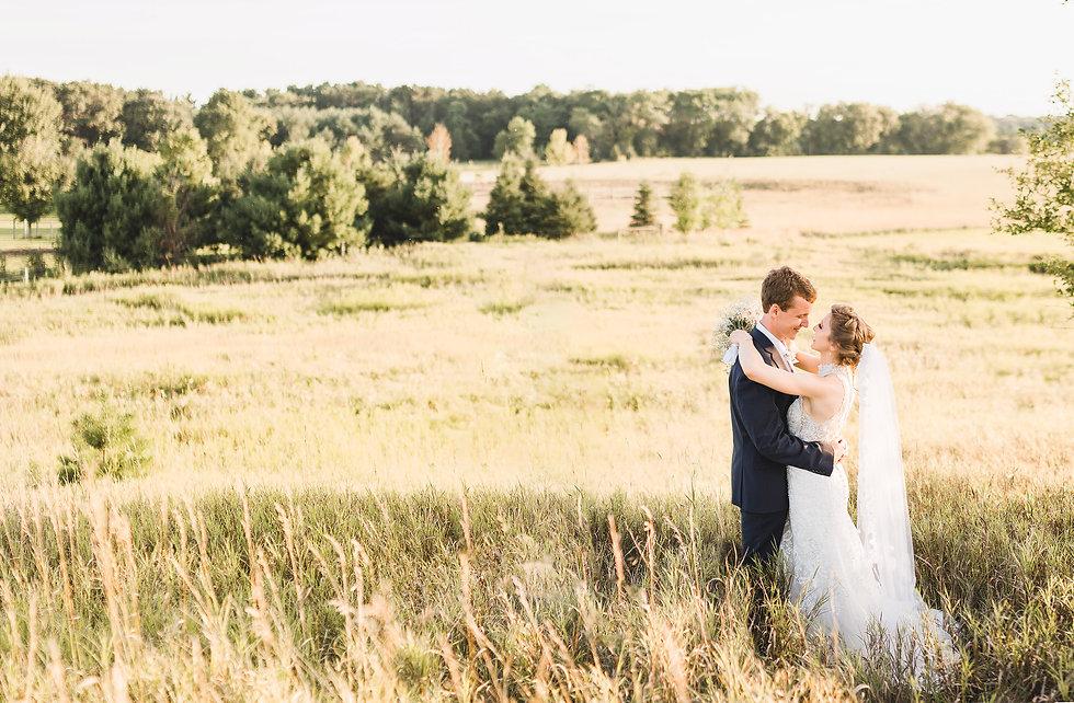 Meagan Elizabeth Photography Minnesota wedding photographer. A bride and groom embrace Stillwater MN backyard wedding