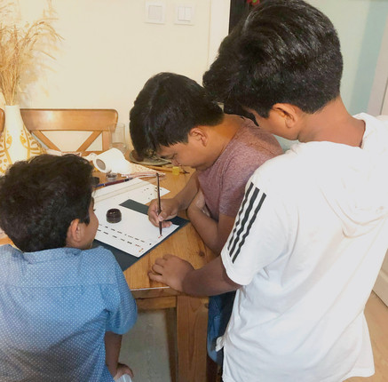 Shahryanshah Sirajuddin teaching students in his home in Istanbul, Turkey. 2019