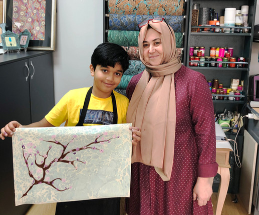 Birgul Tayfur and her student at her  Ebru, paper marbling, atelier in Istanbul, Turkey. 2019