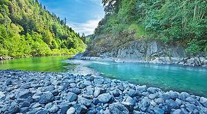 River rocks into River flow.jpg