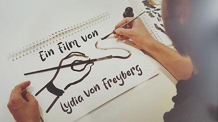 Over-shoulder bei den Dreharbeiten an der Fernsehsendung Zeichner der Zeit, produziert von isar film