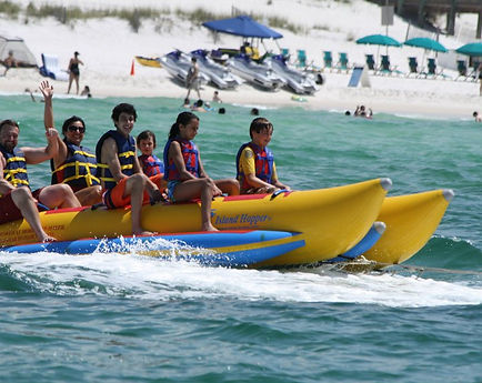 Destin banana boat, beach parasailing destin, pompano joes parasail, gilligans watersports, boogies destin, harborwalk village, tripshock, destin parasail prices