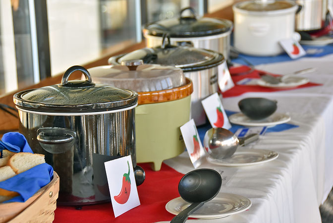 row of crock pots for chili cook off con