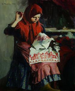 За вышиванием