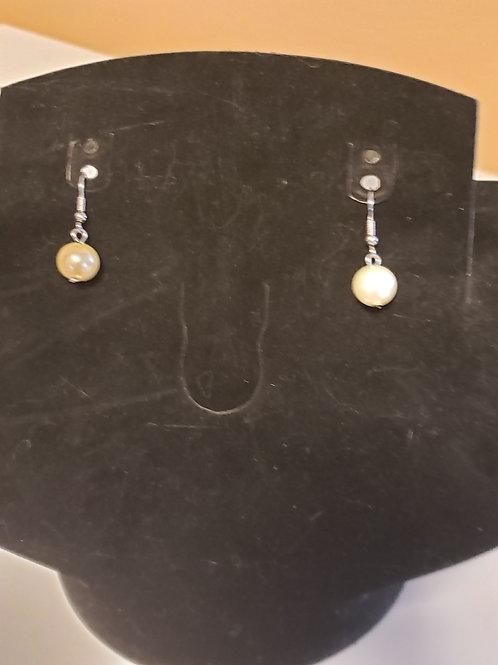 2. Pearl Earrings
