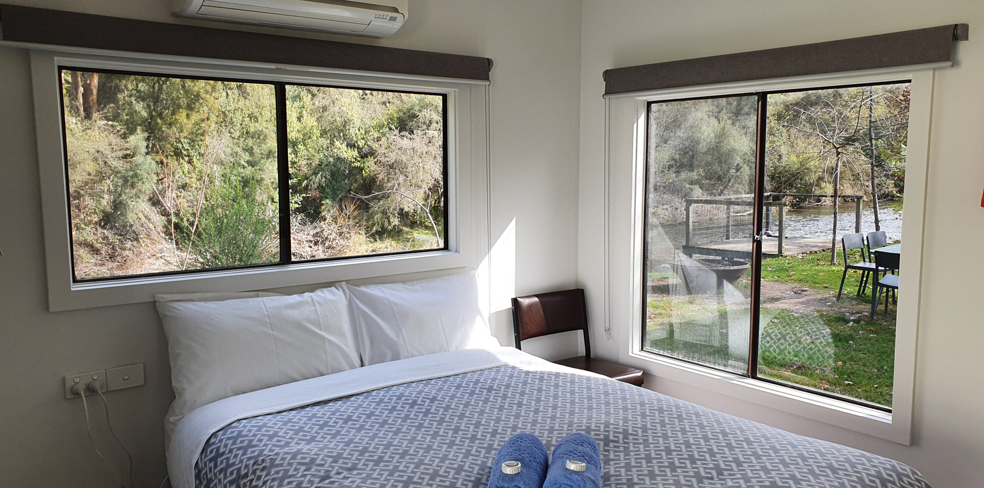 Bed standard riverfront cabin view