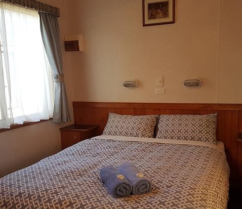 Queen bed couples cabin