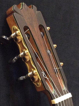 635 scale classical headstock with elegantly simple, mechanically precise tuners by Nicolo Alessi.