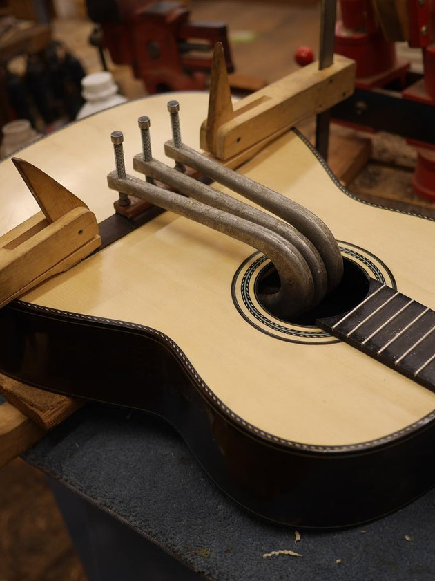 Bridge glued, done by end of week and ready to play. 635mm scale, European spruce/Brazilian rosewood.
