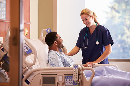 Female Doctor Talking To Male Patient In