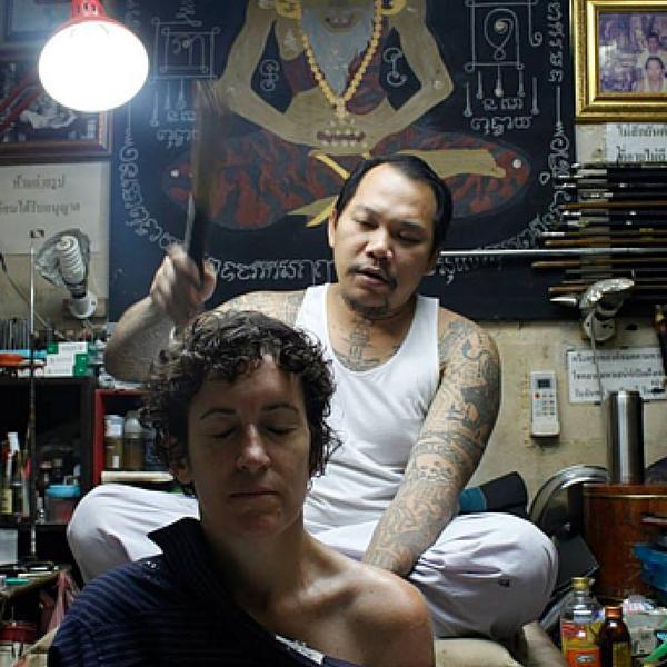Receiving a blessing after getting a Sak Yant tattoo, Bangkok, Thailand