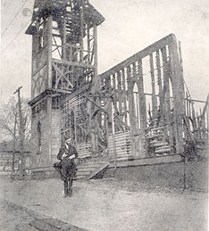 Bryan observes damage from fire