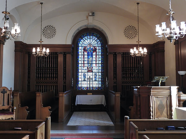 """This is the chapel that was moved from Franklin Street to """"The Brook."""" The central stained glass window of St. Michael is dedicated to the memory of Mr. Carpenter's grandson, Frank Carpenter Manning, who died in 1929 at the age of fifteen."""