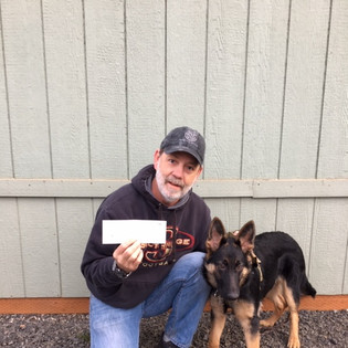 """Jeff displays a donation that we receive annually from """"Get Wet for a Vet"""", one of our awesome sponsors."""