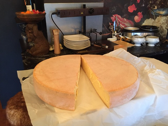 Whole Raclette cheese wheel from France. Remedy Wine Bar Vermont