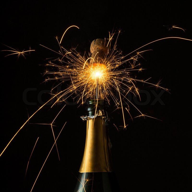 Champaign bottle popping open, cork flying, sparks