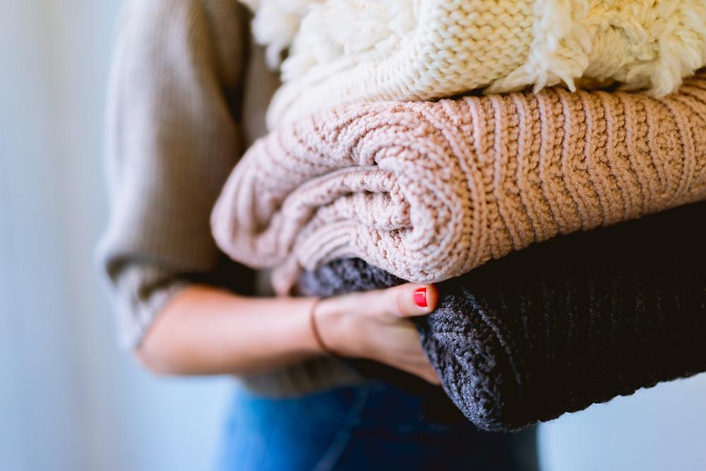 woman holding folded laundry