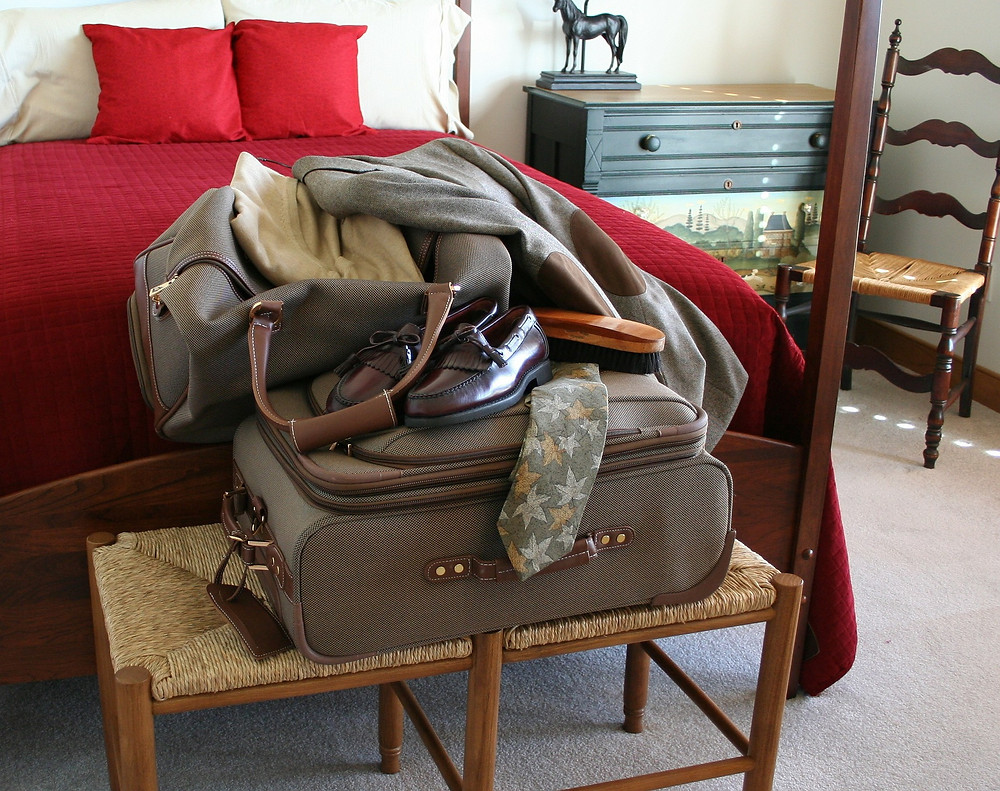 luggage in hotel room, suitcase, shoes, clothes, bed