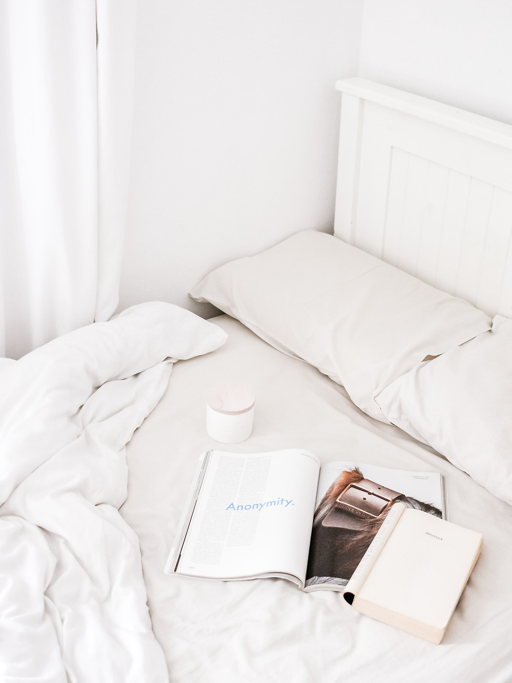 Home, bedroom, clean bed with books and coffee