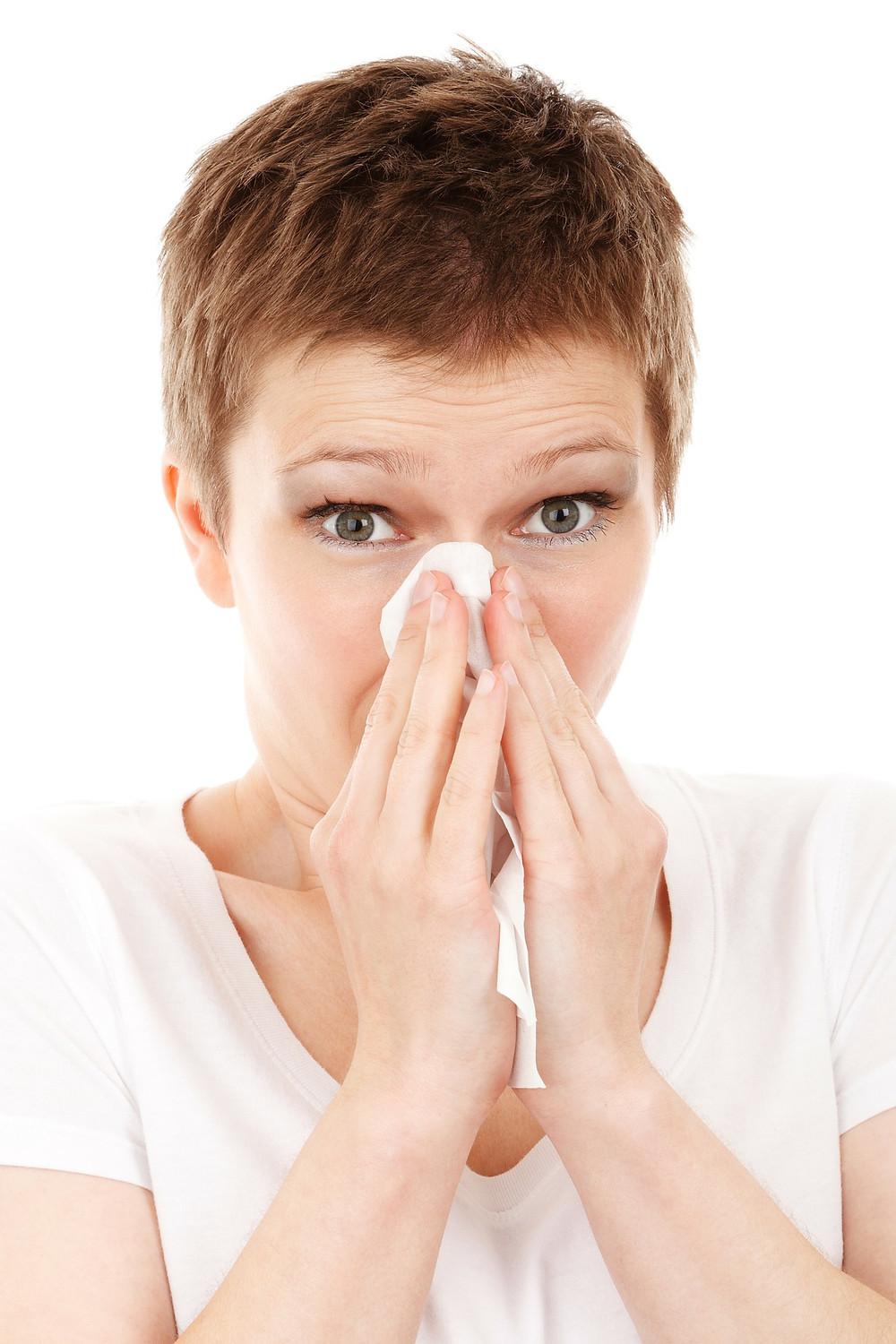 dust allergy woman wiping her nose with tissue