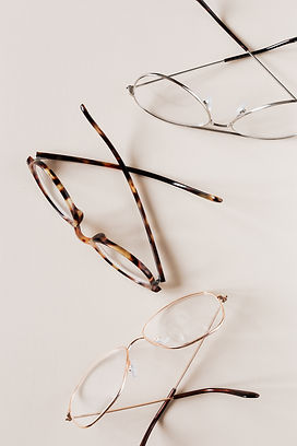 stylish-various-eyeglasses-on-beige-back