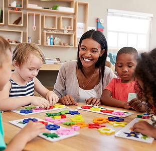 Female school teacher with children