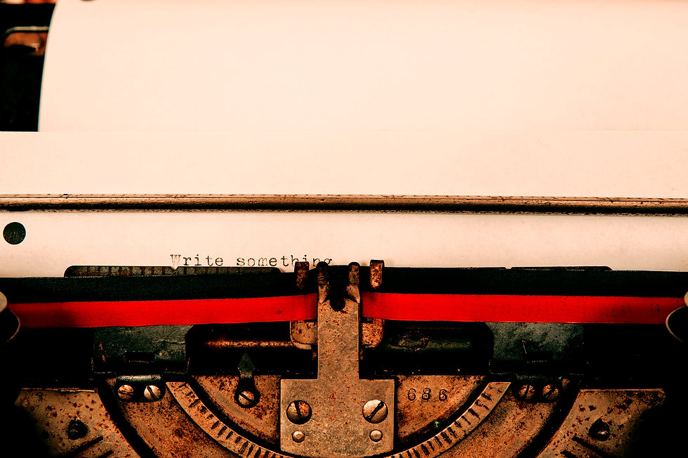 typewriter with paper displaying write something text_edited_edited_edited.jpg