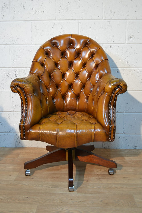 Button back leather chair