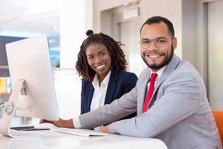 cheerful-business-people-using-desktop-c