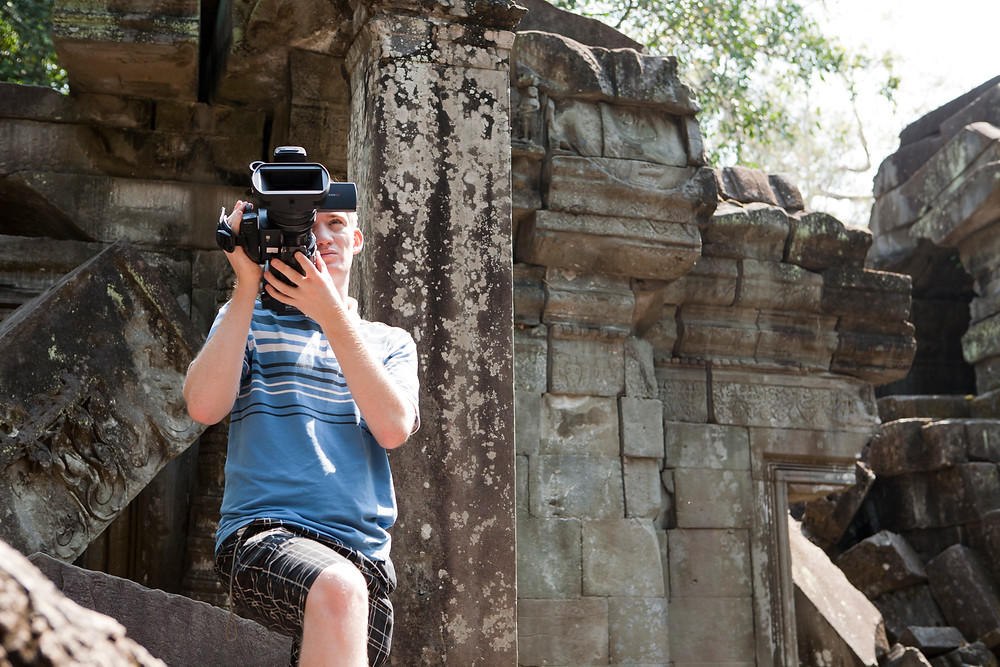 Robin Waldman filming at Angkor Wat temple complex in Cambodia
