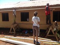 Installing gutters on Career Break in Tanzania