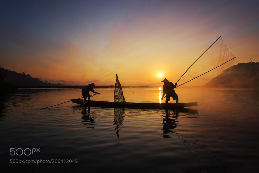 fisherman by SasinTipchai.jpg