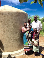 Improving access to clean water. Proud local family, Musoma, Tanzania