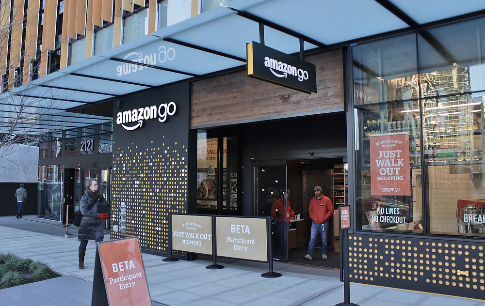 Street view of a busy Amazon Go convenient store in Seattle, WA