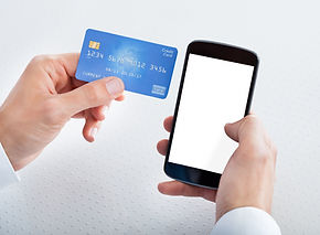 man holding credit card we accept credit and debit cards