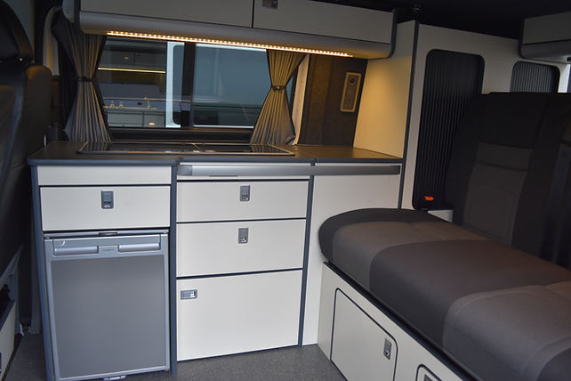 SWB T5.1, Skyline pop top, RIB 112cm bed, cream units, CRX50 fridge, Dometic sink/hob, Evo Motion Design