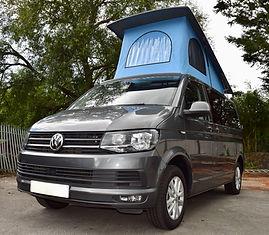 Indium grey Volkswagen Transporter Skyline pop top and bay blue canvas