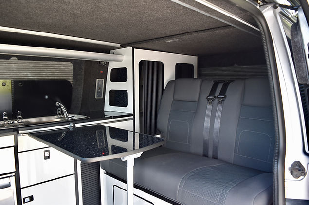 SWB T6 campervan conversion with Hilo roof, gloss white units, refillable Gaslow gas system, Vanshades, Evo Motion Design