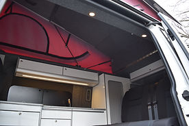 Inside campervan with Skyline pop top roof and bi fold bed board