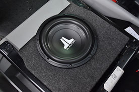 Camper conversion with high quality sound system andhigh-quality audio products at Apple County Customs.