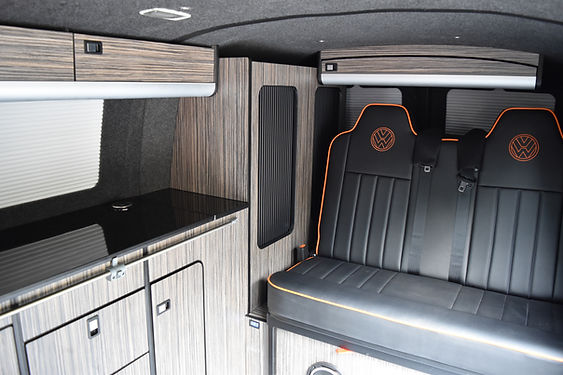 VW T5 conversion 2 berth with Rusty Lee bed black vinyl and orange piping at Apple County Customs Bristol
