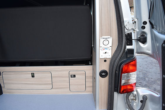 Camper conversion rear shower point supplied by an underslung water tank, allowing for smooth running of the shower for a longer period of time.We also installed a refillable gas system from Gaslow