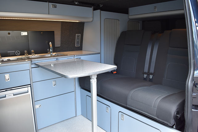 SWB T6 campervan conversion with Skyline Aurora pop top, blue units, 112cm RIB bed, Vanshades, Evo Motion Design