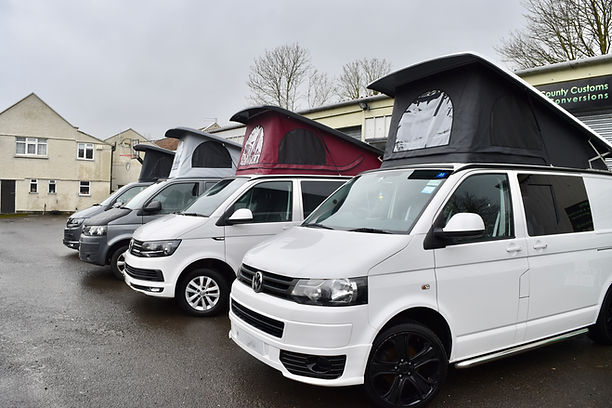 Volkswagen Transporter campervans with Skyline pop top roofs and scenic canvas