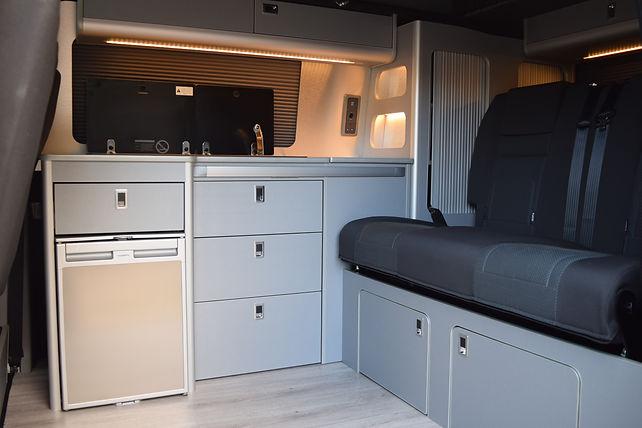 SWB T6 campervan conversion with 112cm black vinyl RIB bed, vanshades, Skyline pop top, Waeco CRX50 fridge, Dometic sink/hob, blue grey metallic units, Evo Motion Design