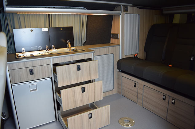 LWB T5.1 campervan conversion with Hilo roof, 129cm RIB bed, Isotherm fridge, Dometic sink/hob, slimline Evo Motion Design units, refillable Gaslow gas system and shower