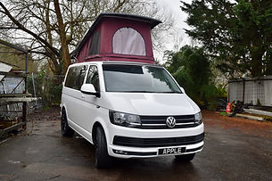 White Volkswagen Transporter with Skyline pop top and burgundy scenic canvas
