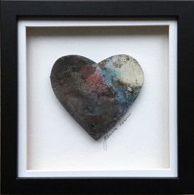 Pitfired heart in a frame