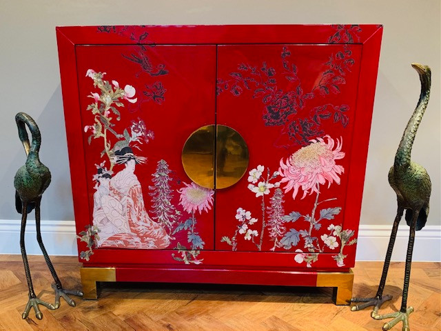 Red lacquered oriental cabinet