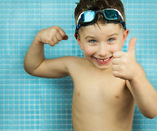 Kid boy at swimming pool..jpg